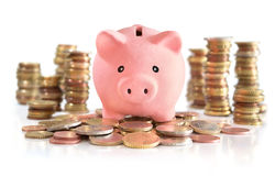 Piggybank on euro money Stock Photos