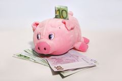 Piggybank and euro notes Stock Photos