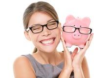Piggybank eyewear de los ahorros de los vidrios Fotografía de archivo libre de regalías