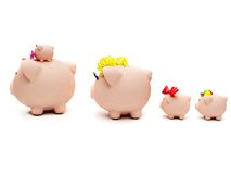 Piggybank family isolated Royalty Free Stock Photos