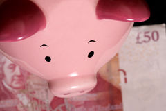 Piggybank with fifty pound note Royalty Free Stock Image
