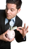 Piggybank Geschäftsmann Lizenzfreies Stockfoto