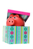 Piggybank in Gift Box Royalty Free Stock Photos