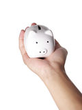 Piggybank and hand. Isolated on white background Royalty Free Stock Images