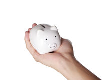Piggybank and hand. Isolated on white background Royalty Free Stock Photos