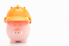 Piggybank with hard hat Stock Photography