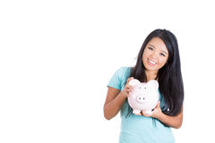 Piggybank held by a sweet little girl Stock Photo