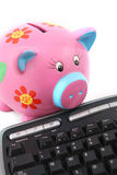 Piggybank and Keyboard. Isolated keyboard and Piggy bank shot over white background Stock Photography