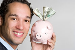 Piggybank Mann Stockfoto