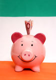 Piggybank med tio euros Arkivbild