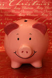 Piggybank with Merry Christmas background Royalty Free Stock Photos