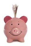 Piggybank met pond Sterling tien Stock Foto