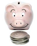 Piggybank met Zilveren Dollars Stock Foto