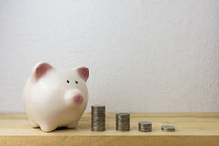 Piggybank and money tower. For money concept Royalty Free Stock Photography