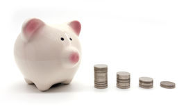 Piggybank and money tower. On white background Stock Image
