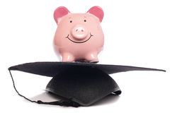 Piggybank with mortar board hat Royalty Free Stock Photo
