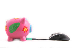 Piggybank and Mouse. Isolated ergonomic computer mouse and Piggy bank shot over white background Royalty Free Stock Images