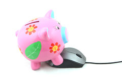 Piggybank and Mouse. Isolated ergonomic mouse and Piggy bank shot over white background Stock Image