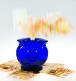 Piggybank op contant geld Royalty-vrije Stock Foto