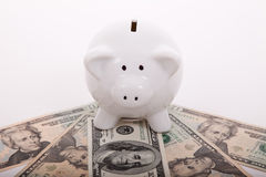 Piggybank over dollar bills Royalty Free Stock Photo