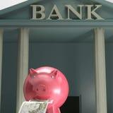 Piggybank på banken visar säkra besparingar Arkivbilder