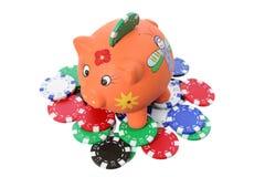 Piggybank and Poker Chips Royalty Free Stock Photos