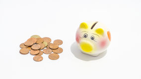 Piggybank and putting coins for business Stock Images