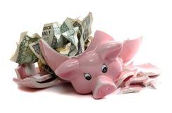 Piggybank quebrado com notas do dólar Imagem de Stock Royalty Free