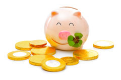 Piggybank with shamrock. Four-leafed clover and piggybank with money Royalty Free Stock Images