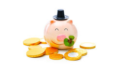 Piggybank with shamrock. Four-leafed clover and piggybank with money Royalty Free Stock Photo