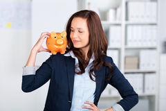 Piggybank on shoulder Stock Photo