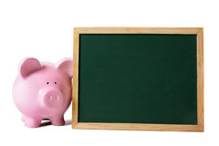 Piggybank small blank blackboard,  on white background, saving money concept Royalty Free Stock Images