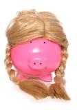 Piggybank som bär en flickaperuk Arkivbild