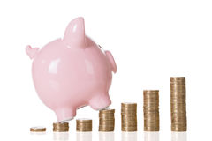 Piggybank On Stacked Coins Royalty Free Stock Photos