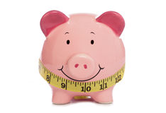 Piggybank with tape measure Stock Image