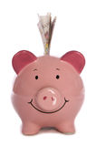 Piggybank with ten pound sterling. Studio cutout Stock Photo
