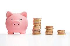 Piggybank: torre del dinero de la pizca de la carta fotografía de archivo libre de regalías