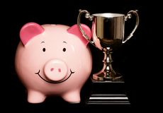 Piggybank with trophy Royalty Free Stock Photography