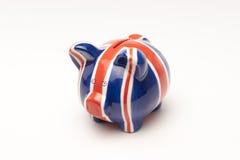 Piggybank UK. British Flag on Piggy Bank, UK Economy Stock Photography
