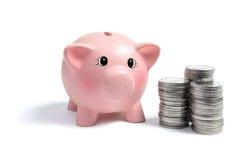 Piggybank und Münzen Stockfotografie