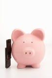 Piggybank und Mobiltelefon Lizenzfreie Stockfotos