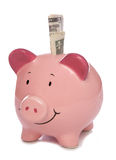 Piggybank with Us dollar money Stock Photo