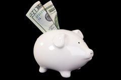 Piggybank with various currency Royalty Free Stock Photos