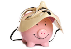 Piggybank and vendetta mask. Studio cutout Royalty Free Stock Photos