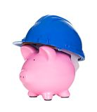 Piggybank wearing construction helmet Royalty Free Stock Images