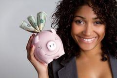 Piggybank Woman. African american woman holding piggybank royalty free stock image
