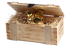Piggybank in wooden box with wood-wool Royalty Free Stock Photo