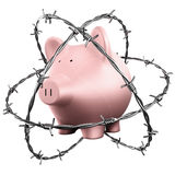 Piggybank wrapped in barbed wire Royalty Free Stock Photo