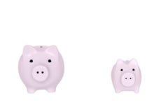 2 piggybanks украшают дырочками изолированное copyspace Стоковое фото RF