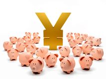 Piggybanks around a yen symbol Royalty Free Stock Photography